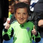 A young West Bromwich Albion fan shows his support to departing manager, Roy Hodgson before the game against Arsenal - Nigel French/EMPICS Sport