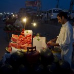 A Pakistani vendor slices water melons for customers at a bus terminal in Rawalpindi, Pakistan. (AP Photo/B.K. Bangash)