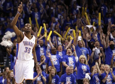 Durant reacts after hitting a basket against the Los Angeles Lakers in the third quarter.
