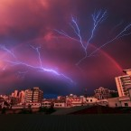 A rainbow appears in the sky as lightning strikes during a rainstorm in Haikou, China. (Photo by Xiangzi/ChinaFotoPress)