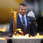 David Beckham with the torch during the ceremony to mark the arrival of the Olympic flame.