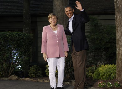 President Barack Obama greets German Chancellor Angela Merkel on arrival for the G8 Summit  Friday, May 18, 2012