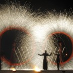 Long exposure photo shows fire spinners whirling fire as they take part in a two-day Fire Festival in Minsk, Belarus. (AP Photo/Sergei Grits)