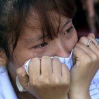 A Cambodian student cries as she watches dancers reenacting the tortures executed by the Khmer Rouge to mark the annual