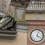 A bell tower clock in Sant'Agostino, northern Italy, displays the time of 4:04 am, Sunday, May 20. 2012, when a magnitude-5.9 earthquake shook northern Italy. (AP Photo/Luca Bruno)