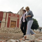 Residents and rescuers walk in front of the collapsed San Martino church, in Buonacompra, near Cento, northern Italy, Sunday, May 20. 2012. A magnitude-5.9 earthquake shook northern Italy early Sunday at 4:04 a.m. Sunday between Modena and Mantova, about 35 kilometers (22 miles) north of Bologna at a relatively shallow depth of 10 kilometers (6 miles). (AP Photo/Luca Bruno)