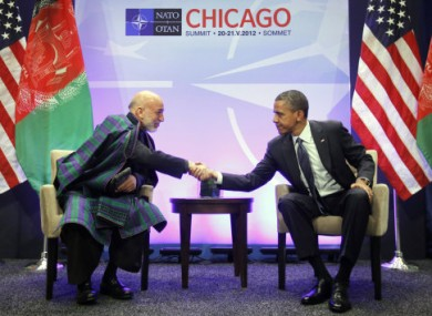 Karzai and Obama at the NATO summit today.