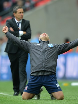 York City's manager Gary Mills celebrates promotion from the BlueSquare Bet Premier Division as Luton manager Paul Buckle looks on.