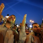 Supporters of Muslim Brotherhood's candidate Mohammed Mursi in the Egyptian presidential election hold a rally Cairo, Egypt. (AP Photo/Fredrik Persson)
