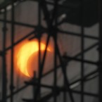 A partial solar eclipse is seen through construction scaffoldings in Beijing, China (AP Photo/Ng Han Guan)