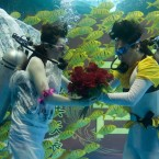 A couple take part in an underwater wedding ceremony at Quanzheng Ocean Polar World in Jinan, Shandong Province of China. (Photo by Guo Jianzheng/ChinaFotoPress)