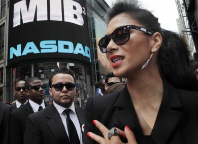 Singer Nicole Scherzinger - who appears in the latest Men in Black film - poses in front of the Nasdaq MarketSite in New York to promote the film.