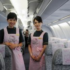 Flight attendants pose on board. (Photo by ChinaFotoPress/PA)