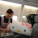 A flight attendant shows the Hello Kitty soft furnishings on board. (Photo by ChinaFotoPress/PA)