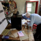 Presiding officer Hugh O' Donnell, right prepares the ballot box on Inishfree Island (AP Photo/Peter Morrison)