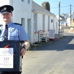 Garda Eugene Organ carrying a ballot box to the polling station for voting on the fiscal treaty referendum on Tory Island (Photo: Artur Widak/PA Wire)
