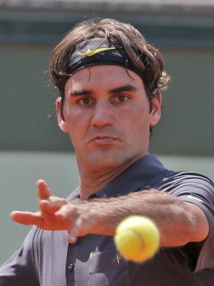 Roger Federer keeps his eye on the ball today.