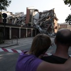 People stand in front a collapsed building in Cavezzo, Italy (AP Photo/Gregorio Borgia)