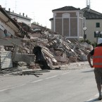 A resuer walks past a collapsed house in Cavezzo, Italy (AP Photo/Gregorio Borgia)