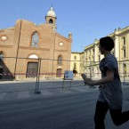 A woman runs in front of Mirandola Dome during a minor aftershock yesterday (AP Photo/Marco Vasini)