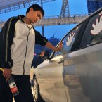 Qiu Jianjun indulges in a special type of athletic endeavour - he competed for five days for the right to use a BMW 1 Series car in Chengdu, Sichuan, China. He had to keep a hands on the stickers and had only a 15-minute break every four hours. (CDSB/ChinaFotoPress/PA Wire)