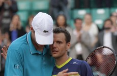 Marathon man Isner beaten in fourth longest in Grand Slam history