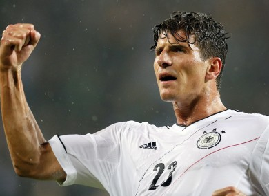 Mario Gomez celebrates scoring his side's opening goal.