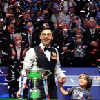 England's Ronnie O'Sullivan celebrates his victory with his son Ronnie after the final during the Final of the Betfred.com World Snooker Championships at the Crucible Theatre, Sheffield.