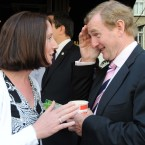 Enda Kenny canvasses Denise Neary from Mayo for a yes vote in tomorrows Fiscal Treaty Referendum outside Caffe di Napoli on Westland Row, Dublin today. 