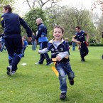A young fan makes a break for it during a game of tag rugby.
