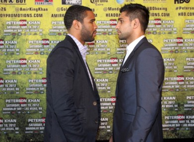 Lamont Peterson and Amir Kahn pose for a photo during a press conference in March.