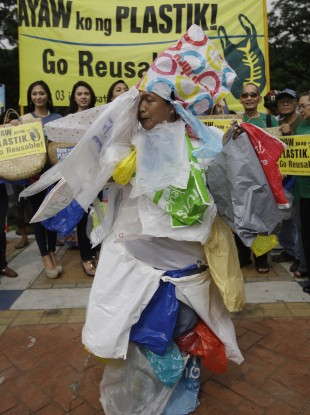 A plastic bag protester wears plastic bags for the International Plastic Bag-Free Day in Manila