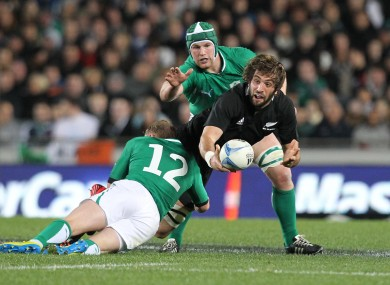 Sam Whitelock is tackled by Keith Earls.