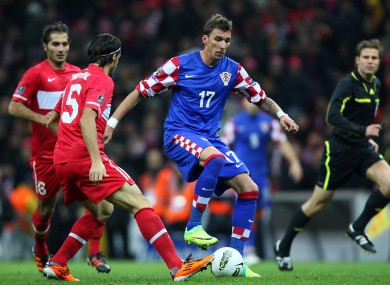 Wolfsburg's Mario Mandzukic scored three goals in qualifying. 