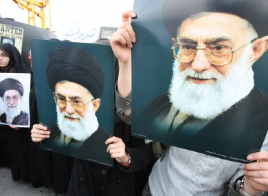 This file photo shows female Iranian students holding posters of supreme leader Ayatollah Ali Khamenei.