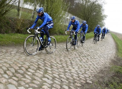 Members of Team SaxoBank ride out.