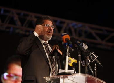 Mohammed Mursi speaks at a rally in Cairo last night as his side claimed victory in the presidential election.