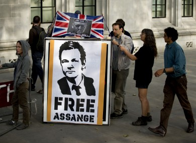 Supporters of Assange pictured last month