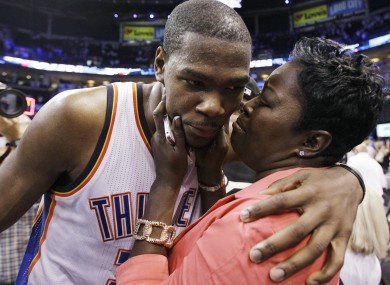 Kevin Durant is congratulated by his mother.