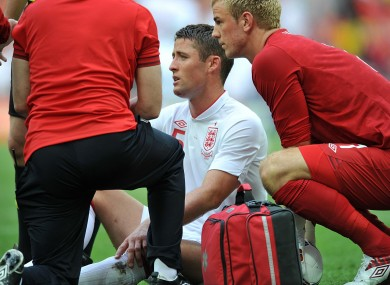 Gary Cahill was injured by England goalkeeper Joe Hart yesterday.