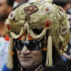 A supporter arrives dressed as Hindu god Krishna as India's anti-corruption crusader Anna Hazare, and Indian Yoga Guru Baba Ramdev, unseen, hold a day long fast near Indian parliament house in New Delhi. (AP Photo/ Mustafa Quraishi)