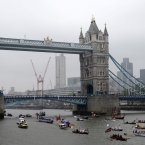 Boats pass under Tower Bridge during the Diamond Jubilee River Pageant.