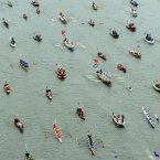 The manpowered section of the Diamond Jubilee River Pageant heads along the River Thames to Tower Bridge, London.