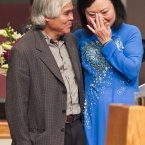 Associated Press staff photographer Nick Ut, left, meets Phan Thi Kim Phuc in Newport Beach, California. Ut captured the iconic black-and-white image of Kim Phuc running naked through the streets with other children after a napalm attack in 1972 during the Vietnam War. It communicated the horrors of the war in a way words could never describe, helping to end one of America's darkest eras. (AP Photo/Damian Dovarganes)
