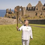 Olympic Torch Relay runner Jean Jones at Dunluce Castle. Image: Ben Birchall