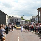 Torch bearer Clare Leahy carries the Olympic Flame through Coleraine. 