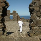Jean Jones holds the Olympic Flame in front of Dunluce Castle.