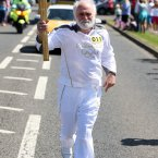 Torch bearer Trevor McClay.