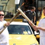 Torch bearer 13 Paul Meikle passes the Olympic Flame onto Philip Carson.