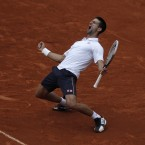 Novak Djokovic psyches himself up during his comeback win against Jo-Wilfried Tsonga at the French Open. (AP Photo/MichelSpingler)